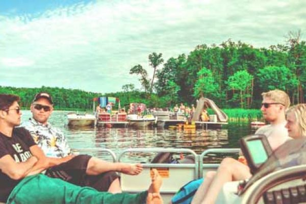 friends relaxing on a pontoon boat